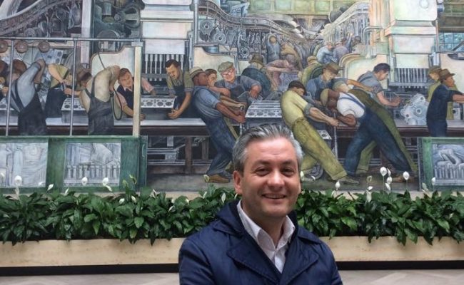 Robert Biedron in front of iconic Diego Rivera mural in Detroit Institute of Arts
